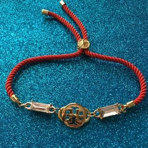 Tory charm on adjustable nylon bracelet